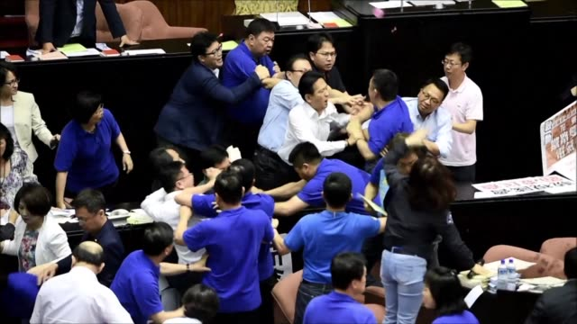 taiwan's parliament descends into chaos for a second consecutive day as they brawl over a controversial infrastructure project - taiwan stock videos & royalty-free footage