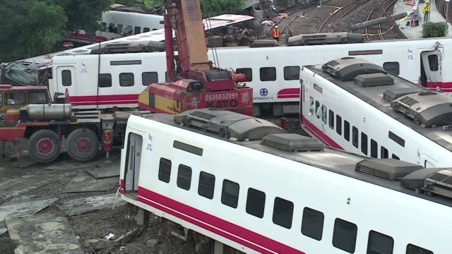 taiwan's president pushes for a swift investigation after an express train derailed on a coastal tourist route killing 18 people in the island's... - tourist train stock videos and b-roll footage