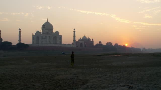 Taj Mahal and boy at sunset