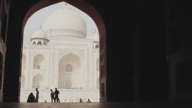 Taj Mahal as seen from one of the side building's arch