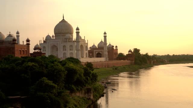 taj mahal during sunset and yamuna river, in agra , uttar pradesh, india - temple building stock videos & royalty-free footage