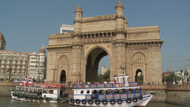 pov taj mahal hotel  and gateway of india seen from boat moving on harbor / mumbai, india - gate stock videos & royalty-free footage