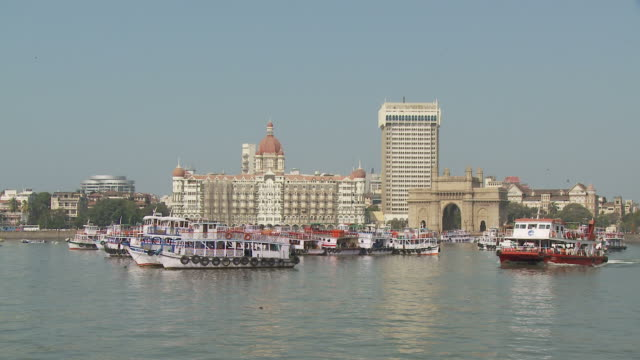 pov taj mahal hotel  and gateway of india seen from boat moving on harbor / mumbai, india - ferry stock videos & royalty-free footage