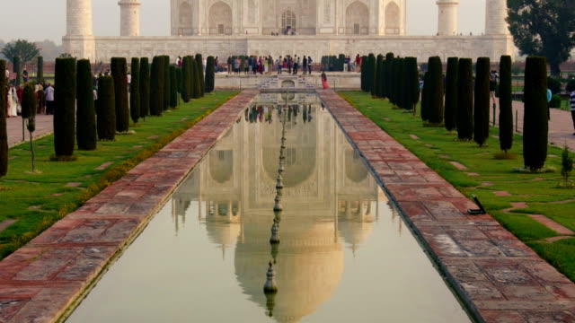 taj mahal panning up - agra stock videos and b-roll footage