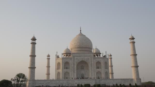 ws pan taj mahal under blue sky / agra, india - agra stock videos and b-roll footage