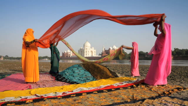 taj mahal, unesco world heritage site, across the jumna (yamuna) river, women drying colourful saris, agra, uttar pradesh state, india, asia - agra stock videos and b-roll footage