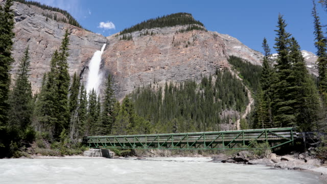 takakkaw falls in canada's yoho national park, british columbia - footbridge stock videos & royalty-free footage