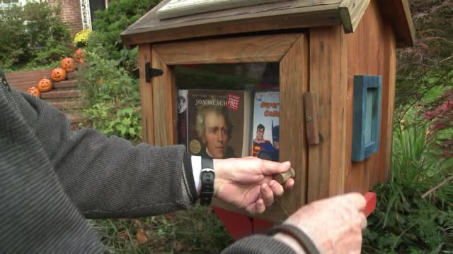 take a book bring a book thats the motto of the free little libraries movement book lovers across the us install wooden boxes in their driveways to... - bethesda maryland stock videos & royalty-free footage