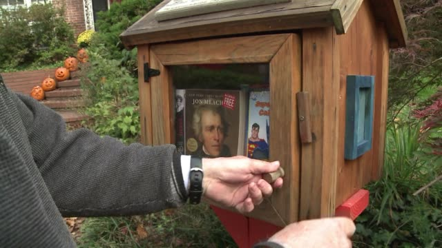 take a book bring a book thats the motto of the free little libraries movement voiced mini libraries bringing us neighborhoods on november 13 2013 in... - bethesda maryland stock videos & royalty-free footage