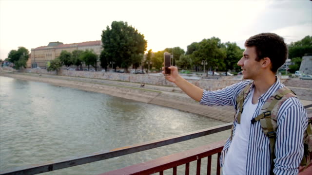 Take a photo with mobile phone on the travel in the big city
