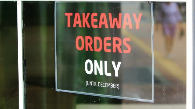 take away only sign on cafe during covid-19 - shop sign stock videos & royalty-free footage