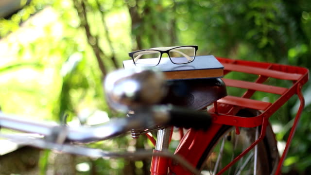 take book and glasses from the bike saddle - saddle stock videos & royalty-free footage