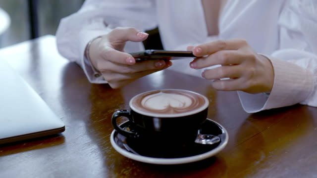 take photos of coffee by smartphone. closeup. - foodie stock videos & royalty-free footage