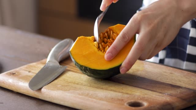 take pumpkin seeds. - cross section stock videos & royalty-free footage
