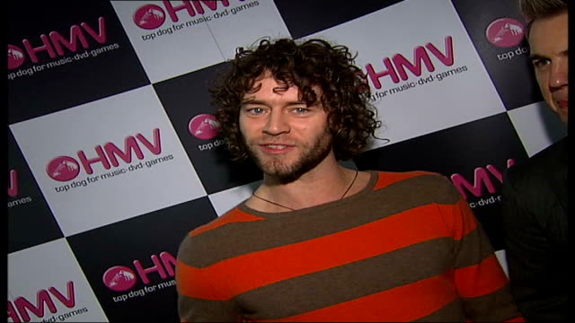 take that appearance at hmv oxford street door opens as take that band members into room chatting to reporter sot / take that band members lined up... - take that stock videos and b-roll footage