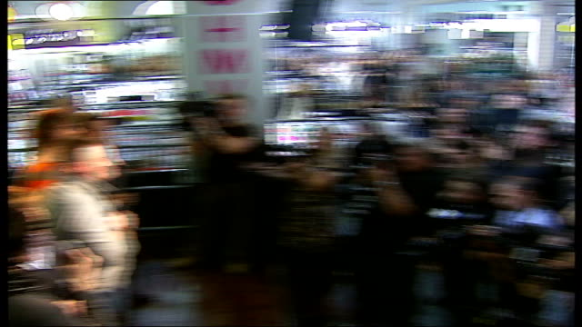 take that appearance at hmv oxford street members of take that band towards thru door pan sot / back view of take that band members on stage with... - アルバムのタイトル点の映像素材/bロール