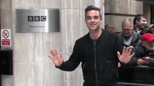 take that group member robbie williams arrives at bbc radio two studios to promote their upcoming tour. celebrity sightings - take that at bbc radio... - bbc radio stock videos & royalty-free footage