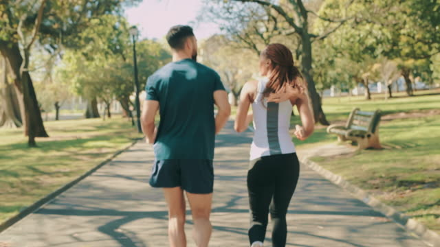take your partner along, it might boost your performance - rear view stock videos & royalty-free footage