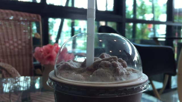 takeaway chocolate frappe - straw stock videos & royalty-free footage