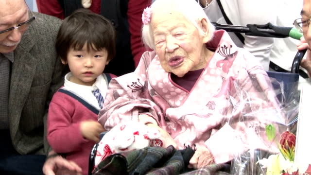 takehiro ogura, mayor of osaka's higashi-sumiyoshi ward, gives birthday wishes and a bouquet of flowers to misao okawa on march 4 the day before her... - 1898 stock videos & royalty-free footage