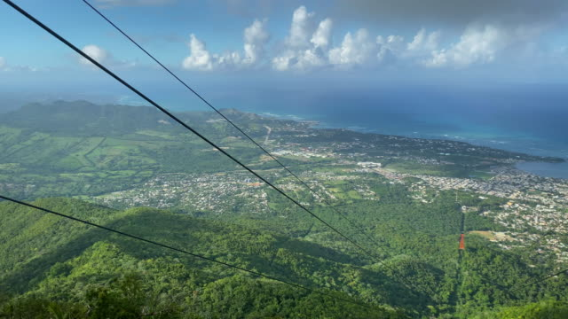 taken from the cable car on the way down, on isabel torres mountain, view of  the forest and the atlantic ocean. - national park stock videos & royalty-free footage