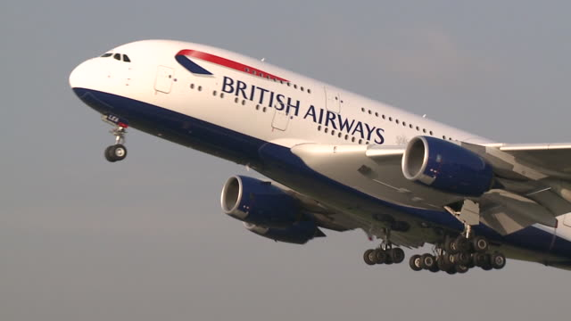 take-off shot of a british airways a380 at heathrow. direct on the front and then sideways close-up as the jet lifts off. a disturbed bird can be... - flughafen heathrow stock-videos und b-roll-filmmaterial