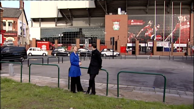 Takeover bid for Liverpool FC from owner of Boston Red Sox EXT Reporter standing with fan outside Anfield James McKenna interview SOT