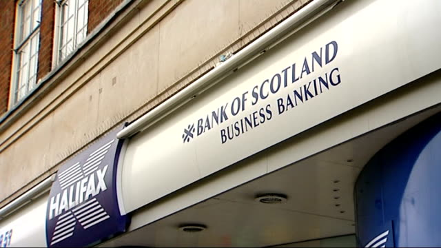 takeover deal between halifax bank of scotland and lloydstsb agreed various views of bank signs for lloyds tsb and halifax bank of scotland as well... - channel 4 news stock videos & royalty-free footage