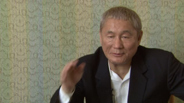 Takeshi Kitano on how the painting with english wording regarding accidents and how it relates and connects to him and the film at the 65th Venice...