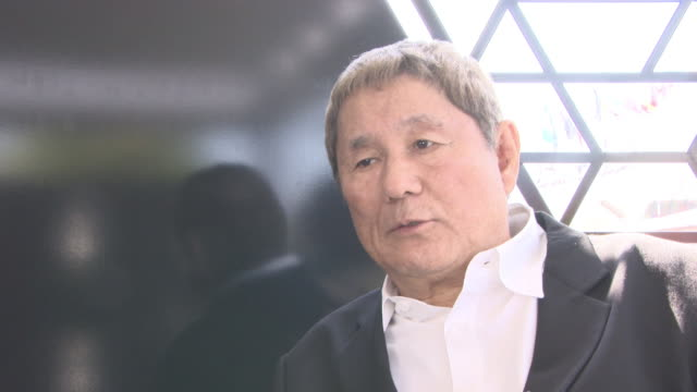 INTERVIEW Takeshi Kitano on how's he's happy to be seen as a director in Venice and worries that some people might hold him in to high a regard in...