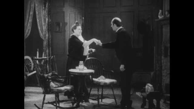 """1929 taking a cue from the novel """"her fatal love"""", a woman approaches the reverend in a revealing manner - sensuality stock videos & royalty-free footage"""