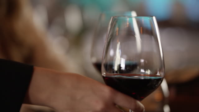 vídeos de stock e filmes b-roll de taking a glass of red wine 4k slow motion - copo de vinho