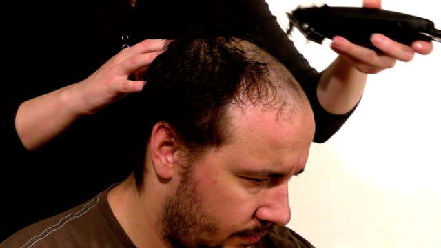 taking a haircut - completely bald stock videos and b-roll footage