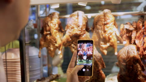 taking a photo : asian chinese food - sharing stock videos & royalty-free footage