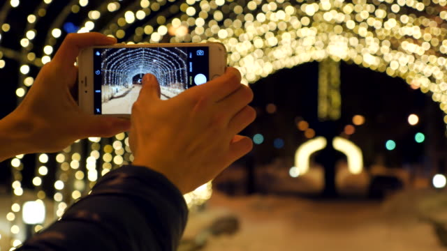 taking a photo at christmas night - filming stock videos & royalty-free footage
