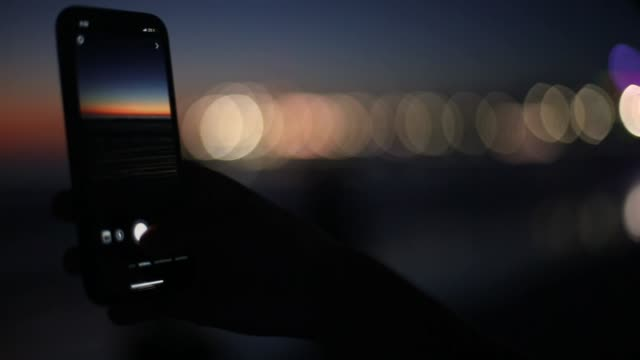 Taking a Photo of the Sunset at Beach