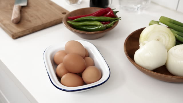 taking a plate of eggs from a sink - kitchen worktop stock videos & royalty-free footage