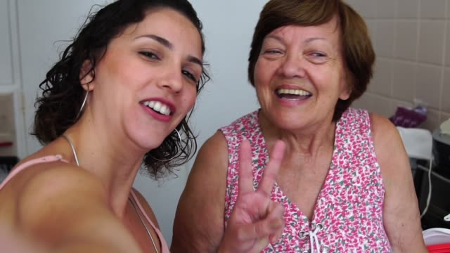 taking a selfie with the grandmother - candid stock videos & royalty-free footage