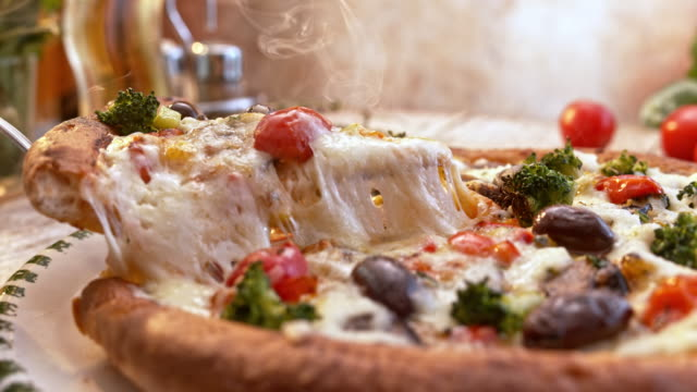 slo mo ds taking a slice of pizza from the plate - food stock videos & royalty-free footage