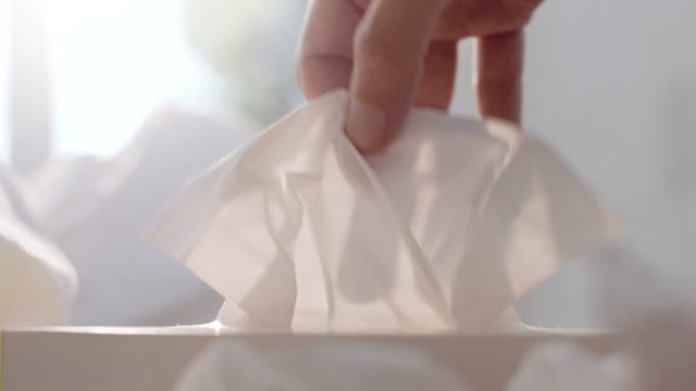 taking a tissue - strofinare toccare video stock e b–roll
