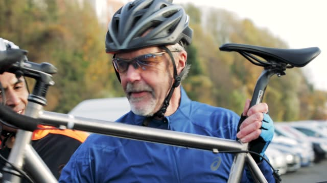 taking bicycle off a car - active seniors stock videos & royalty-free footage