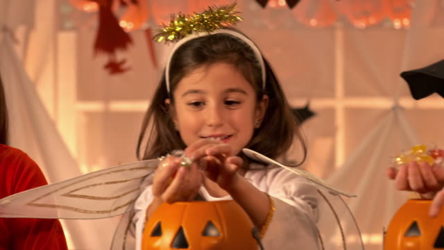 hd dolly: taking candies out of pumpkins - candy stock videos & royalty-free footage