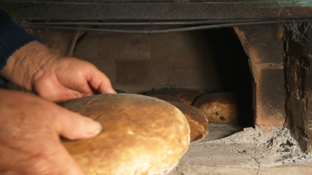 HD: Taking Fresh-Baked Bread From Brick Oven