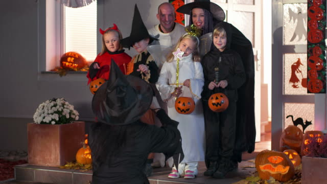 hd dolly: taking halloween group photo - traditional clothing stock videos & royalty-free footage