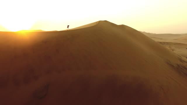 taking in the desert sunrise - namibian desert stock videos and b-roll footage