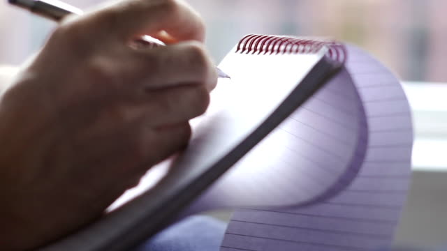 taking notes on a ring binded notepad   inf - letter stock videos & royalty-free footage