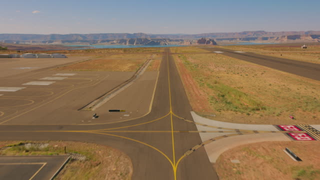 aerial taking off from the airport overlooking lake powell, usa - lake powell stock videos & royalty-free footage