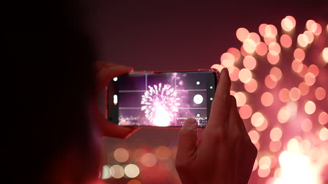 taking photo at celebration firework with smart phone - firework explosive material stock videos & royalty-free footage