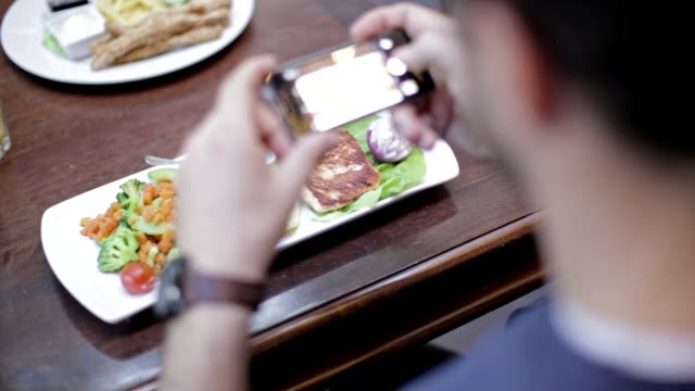 Taking photo of delicious restaurant food