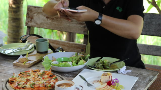taking photo of food with smartphone , mobile photographer - foodie stock videos & royalty-free footage